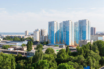 Urban landscape from a height of 12 floors. Modern architecture, multi-storey residential buildings. City Of Saratov, Russia.