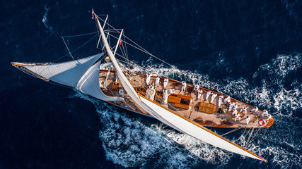French Riviera - old sail race straight above aerial view sunset