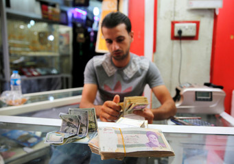 Iranian rials are seen at a currency exchange shop in Baghdad