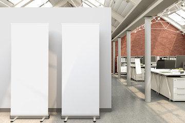 Blank roll up banner stand in office