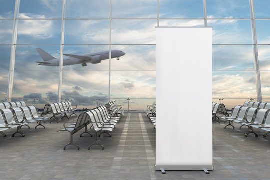 Blank roll up banner stand and airplane on background in airport terminal loung