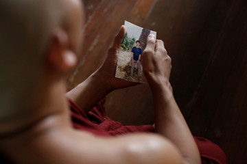 Wa Lone's cousin shows a photo of Wa Lone at the monastery where Wa Lone once lived in Mawlamyine