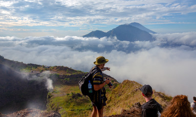 Bali island,Batur volcano,Indonesia / 21 jul 2018 : Tourist show the way to  Batur volcano view point,sunrise time