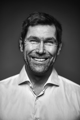Portrait of smiling man, black and white
