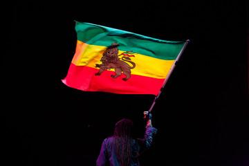 black man waving jamaica flag