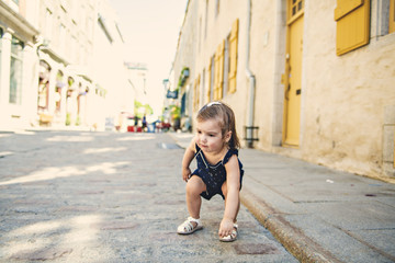 two years old child girl on urban street