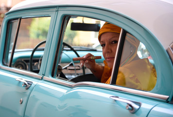 "Cuban singer Rodriguez sits in a Buick Century classic car as the Grammy-award winning performer stars in the musical ""Carmen La Cubana"" at Sadler's Wells in London, Britain"