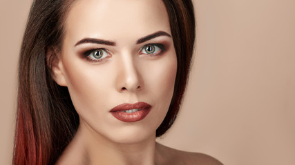 Portrait of gorgeous young brunette woman with bright makeup