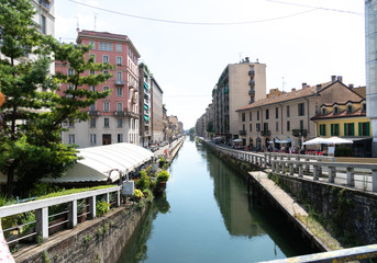 Naviglio grand canal. Navigli were a system of navigable and interconnected canals around Milan. Today, the Naviglio Grande and the Naviglio Pavese are a nightlife pole