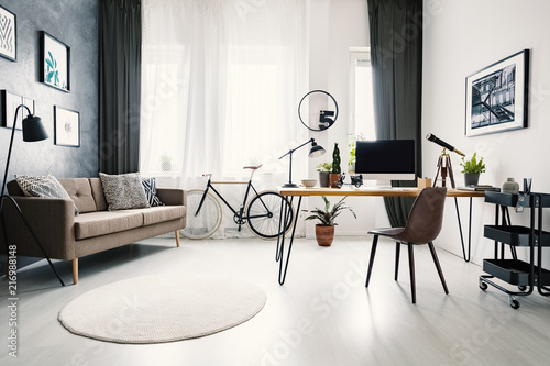 Modern Home Office Interior With A Big Window, Sofa, Bike ...