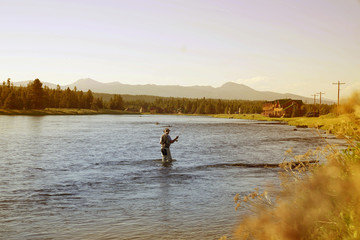 Fisherman flyfishing in river of Idaho state