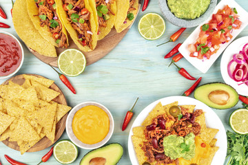 Overhead photo of an assortment of Mexican foods with copy space