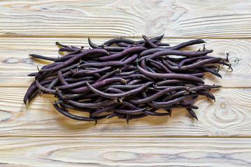 heap of france violet beans in retail vegetable super market for sale