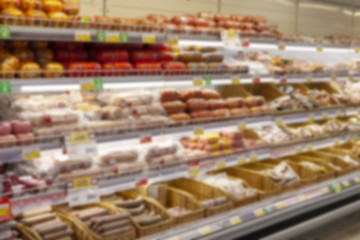 Blurred photos showcases shops. Long rows of racks with goods.
