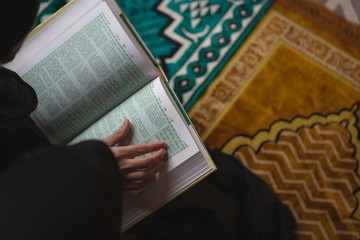 Muslim woman reading holy Quran