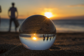 Sunset at Beach with Glass Ball and Silhouette