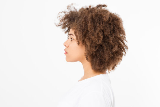 African american woman face profile isolated on white background. Copy space. Curly hair and skin care concept.