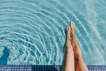 Legs of woman at pool