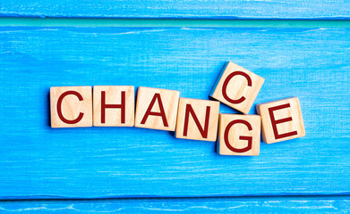 "Wooden cube with word ""change"" to ""chance"" on wood table. Personal development and career growth or change yourself concept. concept of motivation, goal achievement, potential, incentive, overcoming"