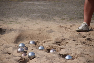 Jeu de boules game on a floor of sand on the town hall square in Nieuwerkerk aan den IJssel in the Netherlands