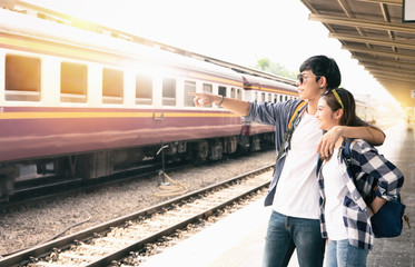 Young couple are travelling to up country by the train
