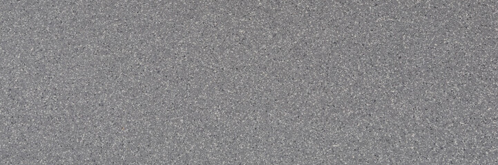 Background of gray granite with a texture of black and white spots.