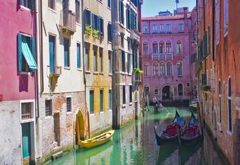Beautiful romantic Venetian cityscape with gondolas