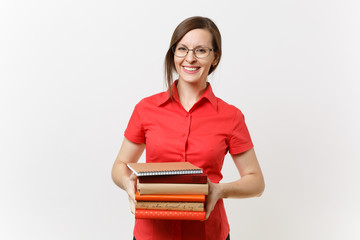 Portrait of beautiful young business teacher woman in red shirt glasses holding stack text books in...