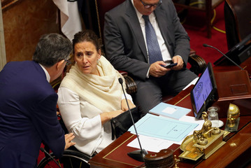 Argentina's Vice President and President of the Senate Gabriela Michetti listens as lawmakers meet to debate and vote on a bill that would legalize abortion, in Buenos Aires
