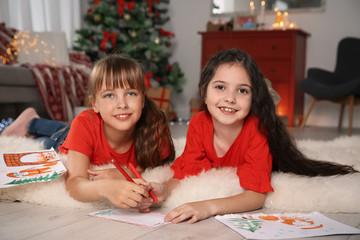 Little children writing letter to Santa at home. Christmas celebration