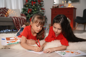 Little children writing letter to Santa at home. Christmas celebration