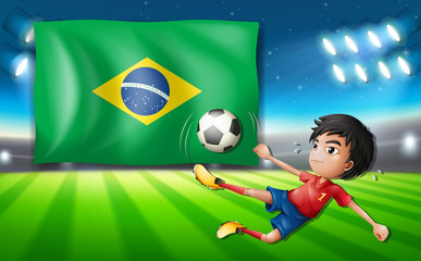 Boy soccer player infront of brazil flag