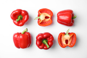 Flat lay composition with raw ripe paprika peppers on white background