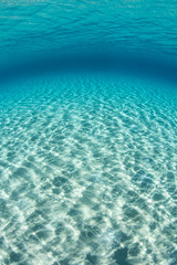 Bright Sunlight Ripples Across Sandy Seafloor in Tropical Pacific