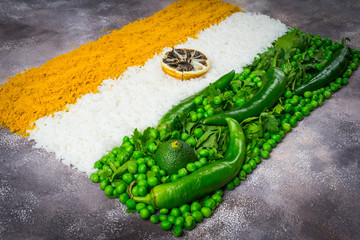 India Independence Day 15 August concept: Indian National Flag tricolor from vegetables. Top view. Gray background