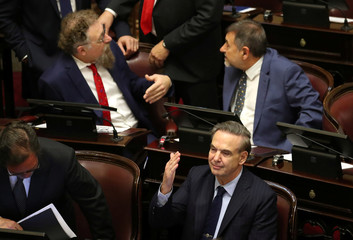 Senator Miguel Angel Pichetto gestures as lawmakers meet to debate and vote on a bill that would legalize abortion, in Buenos Aires