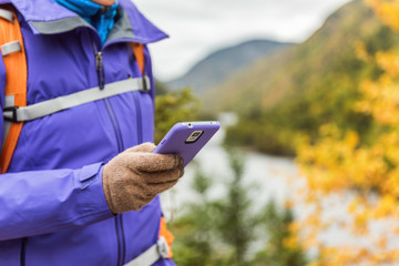 Travel person using smartphone app gloves outdoors