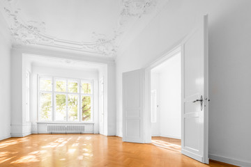 empty apartment room, flat with wooden floor and stucco ceiling