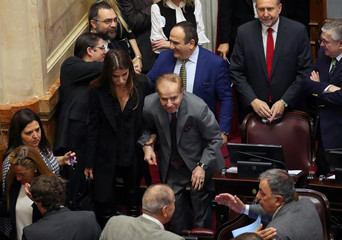 Senator and former Argentine President Carlos Menem arrives with his daughter Zulema as lawmakers meet to debate and vote on a bill that would legalize abortion, in Buenos Aires