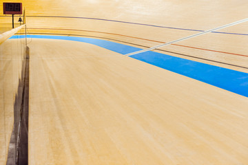 Velodrome cycling track empty curved high wooden floor with markings Trinidad and Tobago, sporting venue.