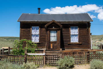 Abandoned, rustic wood-sided home in the ghost town of Bodie in California