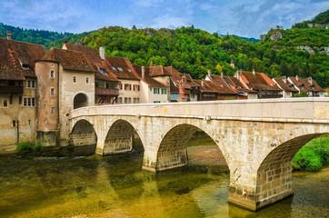 Saint-Ursanne mit steinerner Bogenbrücke, Kanton Jura, Schweiz