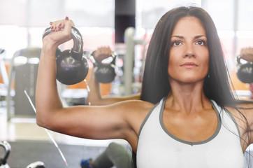 Woman doing biceps workout
