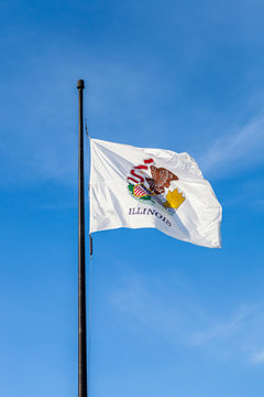 Flag of the American state Illinois waving in the wind with sky in the background