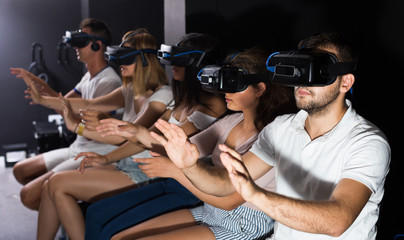 females and males try modern virtual reality glasses