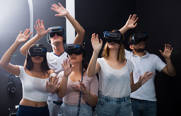 females and males immersed in virtual reality with 3d glasses
