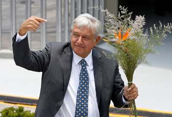 Mexican President-elect Lopez Obrador gestures after being formally installed as the country's next president, outside the headquarters of the electoral authority in Mexico City