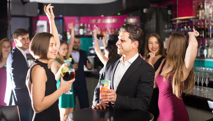 Men and women dancing on corporate party