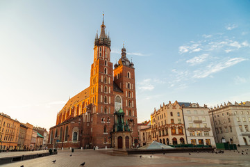 Fototapeta St. Mary's Basilica in Krakow, Poland, famous brick church with two towers, located on the market square in the historic centre at sunrise. obraz