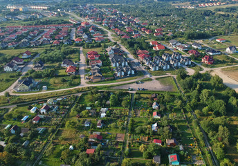 Aerial view on city housing area with many buildings, roads and garden